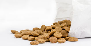 Dog food with paper bag Royalty Free Stock Image