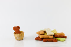 Dog food, Pile of dog biscuits in the shape of a bone. Stock Image