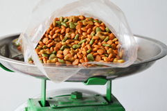 Dog food in plastic bag on stainless weighting scale tray Royalty Free Stock Photos
