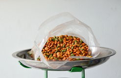 Dog food in plastic bag on weighting scale tray Stock Photo