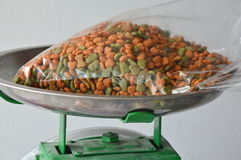 Dog food in plastic bag on weighting scale tray Royalty Free Stock Photo