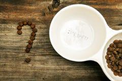 Dog food question symbol. Studio stock photography