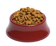 Dog Food. Red Bowl of Dog Food Isolated on White Background stock photos