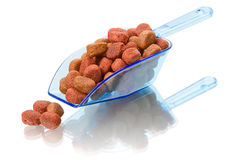 Dog food in a scoop. Dog food in a plastic scoop.  on white background Royalty Free Stock Photo