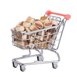Dog food in a shopping cart. Dog food in a small ,metal shopping cart, isolated on white background Stock Photos