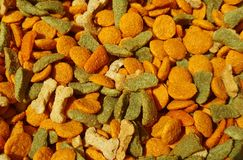 Dog food. In various shapes and colors Stock Photography