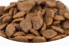 Dog food on white Stock Images