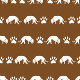 Dog and footprints brown shadows silhouette in lines pattern eps10 Royalty Free Stock Photography