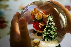 Dog in the form of Santa Claus, Christmas tree and baby`s hands stock images