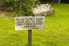 Dog foul sign in graveyard Royalty Free Stock Images