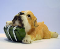 Dog with a gift. Ceramic figure of a dog with a gift. The close up Royalty Free Stock Photo