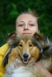 Dog and girl. Portrate of red collie dog and young woman Stock Image