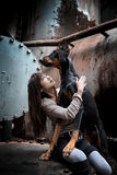 Dog and girl. Portrait of a girl with her doberman dog stock photography