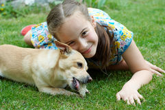 Dog and girl. Girl and dog in the garden Stock Photos