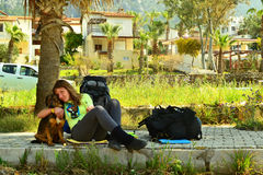Dog and girl under the palm tree. Royalty Free Stock Photos
