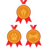 Dog gold medal set. prize with red ribbon with a picture of a doghouse, bones and foot marks. The dog gold medal set. prize with red ribbon with a picture of a Royalty Free Stock Photography