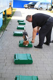 Dog handlers are trained in the customs dogs to look for drugs and weapons Stock Photo
