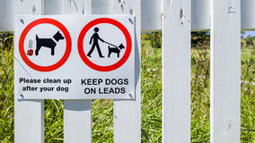 Dog Health and Safety Signs. Health and safety notice at the entrance to a public footpath asking dog owners to keep their dogs on a lead and clean up after them Stock Photography