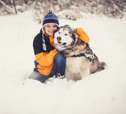 Dog and his owner - Cool dog and young man Royalty Free Stock Photography