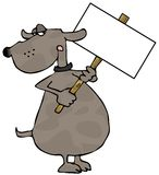 Dog Holding A Sign Royalty Free Stock Photography