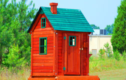 Dog house. A colorful animal shelter house waiting for a good home Royalty Free Stock Image