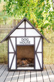 Dog house with puppies sleeping inside royalty free stock images