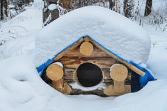 Dog house in the winter with snow on roof royalty free stock photo