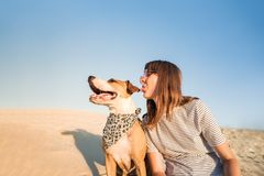 Dog and human make fun, posing as best friends. Funny female per stock photos