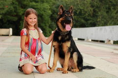 Dog and kid Stock Photos