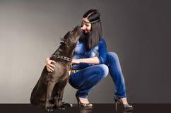 Dog kissing girl. Dog kissing a beautiful young smiling girl Stock Photography
