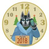 The dog Laika Husky a happy new year 2018. The dog Laika Husky with a mobile phone wishes all a happy new year 2018, the clock struck twelve, and there came the Royalty Free Stock Photo