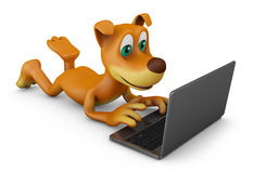 Dog with a laptop Stock Photography