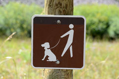 Dog on leash sign Stock Images