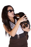 Dog licking woman Royalty Free Stock Image