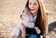 Dog licks  her mistress Stock Images