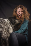 Dog licks his owner's face Stock Images