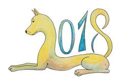 The dog lies and figures 2018 as a symbol for the new year stock photography