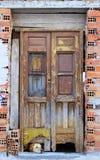 Dog looks under door. Dog looks under old wooden door Royalty Free Stock Photography