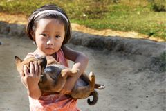 Dog Lovers. A girl holding her loving dog at the Nishi village of arunachal pradesh in India stock photos
