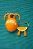 Dog made of orange and grape Stock Photos