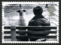 Dog and Man Sitting on Bench