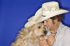 Dog and man wearing cowboy hat stock photo