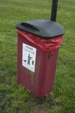 Dog mess trash can. UK Dog mess / poo / feces disposal receptacle Royalty Free Stock Photo