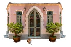A dog neat house with sitting on the front door waiting in white stock image