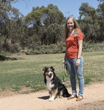 Dog Obedience Woman and Dog Sit Stay. A young woman practising a Sit Stay for dog obedience training Royalty Free Stock Photo