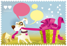 Dog opening a gift Stock Photos