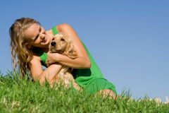 dog owner. Happy young woman playing with pet dog Royalty Free Stock Photo