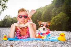 Dog and owner at the beach Royalty Free Stock Image
