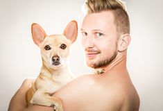 Dog and owner embracing Royalty Free Stock Photos