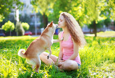 Dog and owner girl outdoors Royalty Free Stock Image